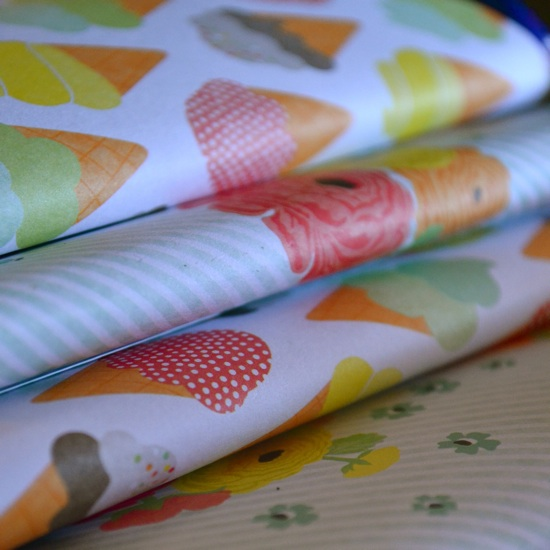 candy bars wrapped in cute scrapbook paper for a baby shower // the lovely bee